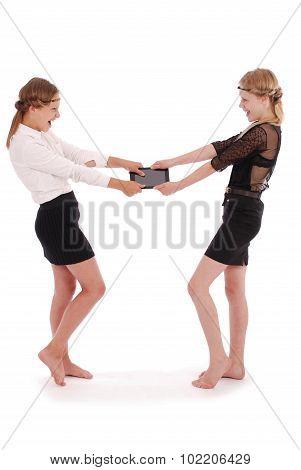 Girls Tearing Tablet Pcs