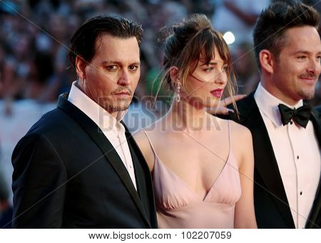 Scott Cooper, Johnny Depp, Dakota Johnson, Joel Edgerton at the premiere of Joel Edgerton at the 2015 Venice Film Festival. September 4, 2015  Venice, Italy
