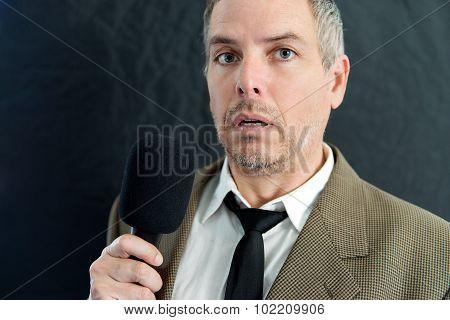 Depressed Man Speaks Into Microphone