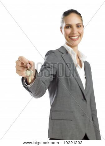 Young Confident Businesswoman Holding A Key