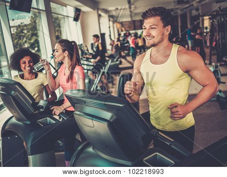 Man running on a treadmill in a gym