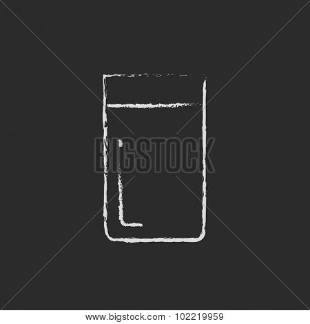 Glass of water hand drawn in chalk on a blackboard vector white icon isolated on a black background.
