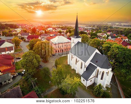 Beautiful sunset over gothic church St. Peter and Paul in The Litice suburb of Pilsen. Aerial view to romantic citiscape in Czech Republic, Central Europe. HDR (warm filtered) photography.