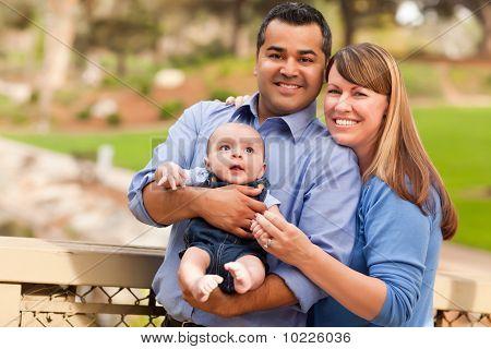 Interracial Family Posing For A Portrait