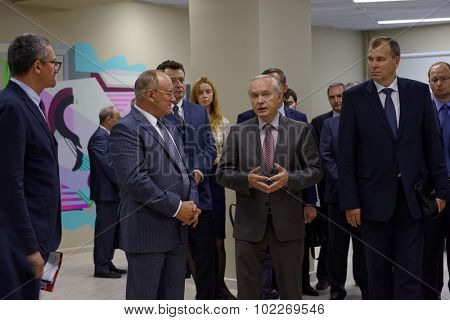 ST. PETERSBURG, RUSSIA - SEPTEMBER 3, 2015: 1st Vice-rector Alexander Shamrin (center) talking with Vice-Governor of St. Petersburg Vladimir Kirillov during the opening of new academic building of HSE