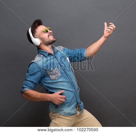 Handsome hipster man in earphones