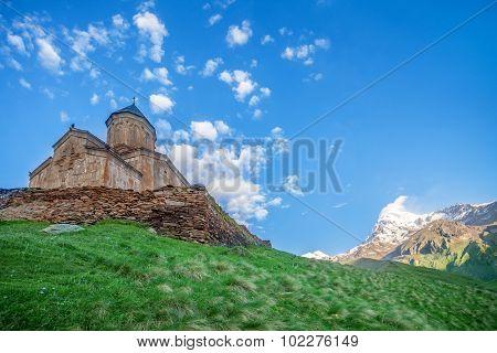 Holy Trinity Church near Mount Kazbek in Georgia. Tsminda Sameba. Mediaeval Church in mountains