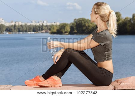Young girl drinking water on the breather