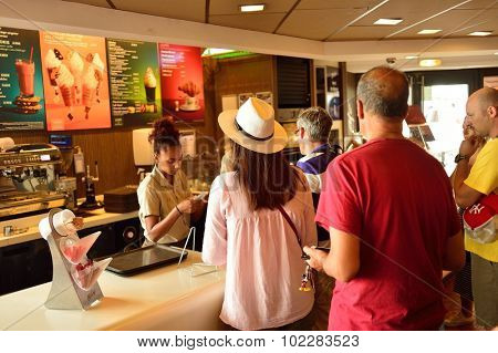 NICE, FRANCE - AUGUST 15, 2015: McDonald's restaurant interior. McDonald's is the world's largest chain of hamburger fast food restaurants, founded in the United States.