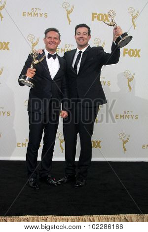 LOS ANGELES - SEP 20:  Mark Burnett, Carson Daly at the Primetime Emmy Awards Press Room at the Microsoft Theater on September 20, 2015 in Los Angeles, CA