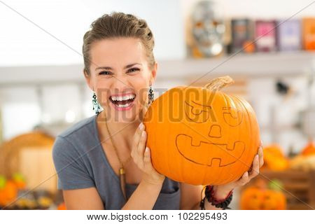 Portrait Of Woman With Pumpkin Jack-o-lantern For Halloween