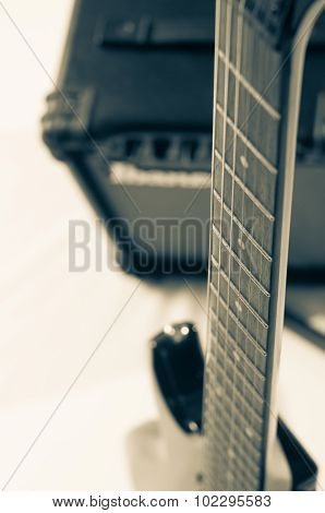 Detail of six-string electric guitar closeup selective focus.Processed with vintage style.