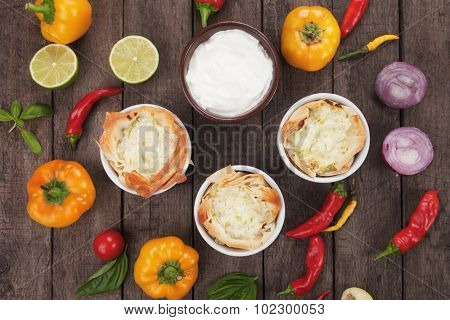 Phyllo pastry cups filled with cheese and zucchini