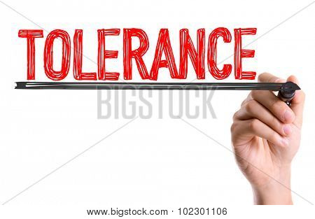 Hand with marker writing: Tolerance