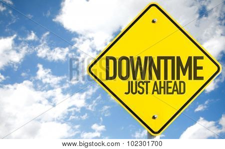 Downtime Just Ahead sign with sky background