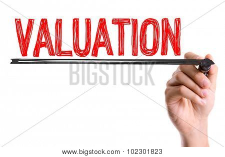 Hand with marker writing: Valuation
