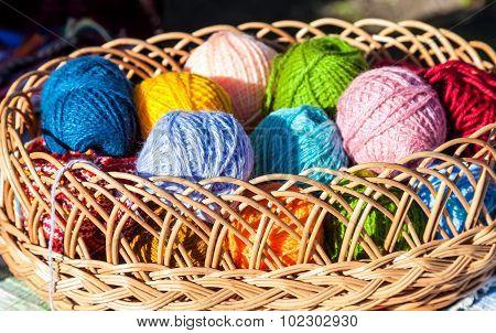 Bright Multi-colored Balls Of Yarn In Wicker Basket