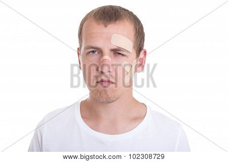 Sad And Injured Man With Adhesive Plaster On His Face