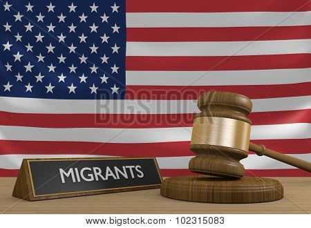 Wooden court gavel and a plaque labeled migrants in front of the flag of the United States. poster