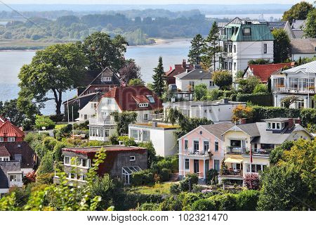 Hamburg Germany - Blankenese famous suburb of narrow pedestrian paths and stairways. View with Elbe river. District of Altona. poster