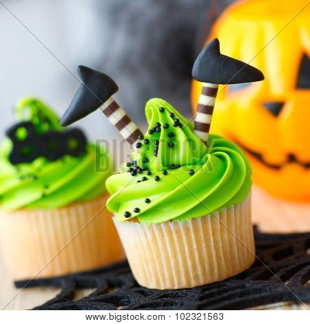 Halloween cupcake decorated with witch's legs