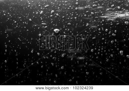 Water drops on metal surface of car after anti rain coating