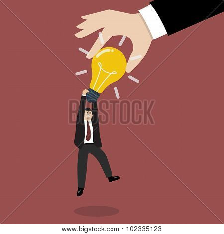Hand Stealing Idea Light Bulb From Businessman