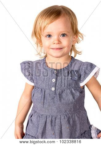 Cute little girl in a studio with white background