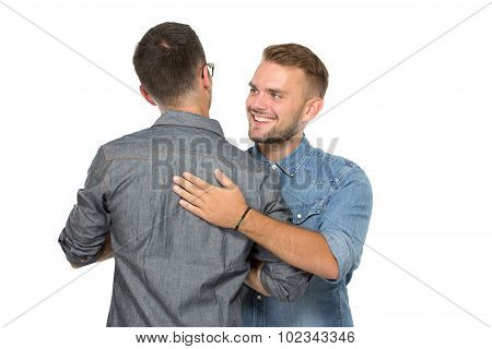 Two Young Man Greeting Each Other, Smiling
