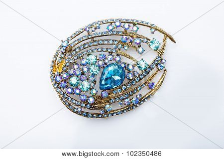 brooch with colored stones