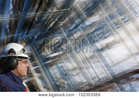 oil and gas worker with giant pipelines construction, slight zoom effect on background