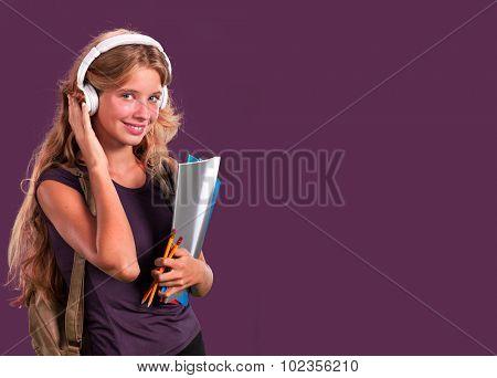 Student girl in headphones holding notebook. poster