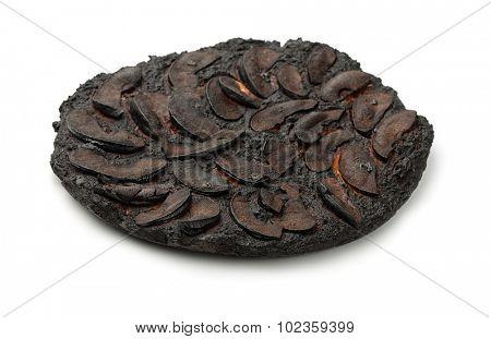 Burnt apple cake isolated on white