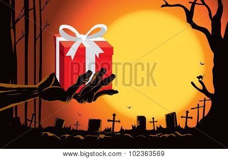 Zombie hand holding gift box at the grave