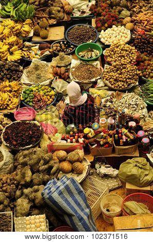 Vegetable and wet market. Muslim woman selling fresh vegetables at Siti Khadijah Market market in Ko