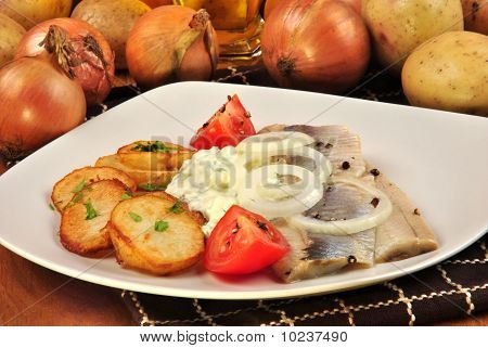some fresh organic herring with roasted potato poster