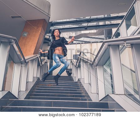Beautiful Girl Jumping From A Staircase