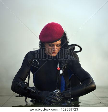 beautiful caucasian diver woman in the water