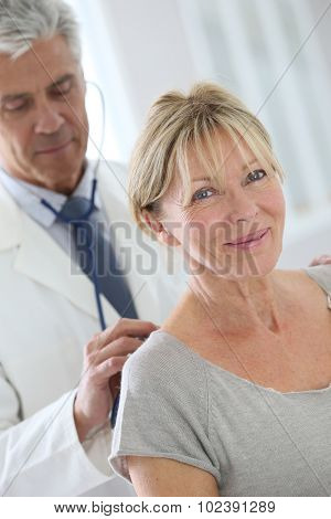 Senior woman in doctor's room for consultation