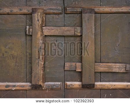 Close up old wood door with lock.