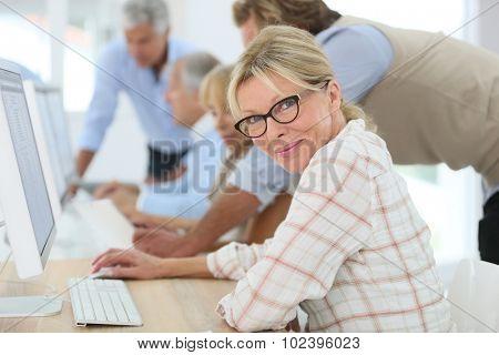 Senior woman attending training business class