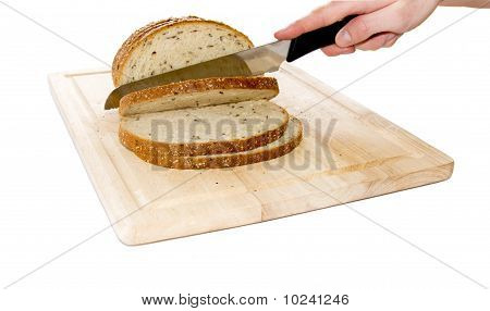 Bread Cut By Knife On Kitchen Board