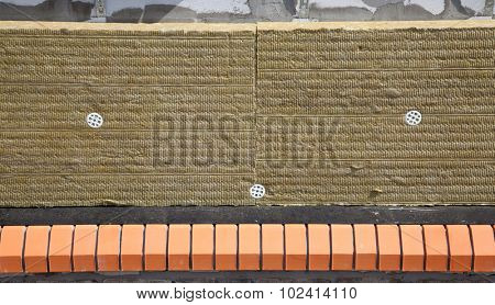 Wall of Bricks and Insulation Wool