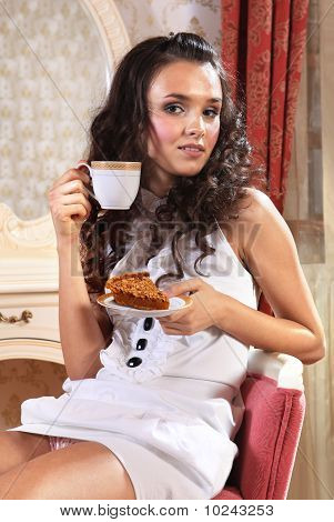 girl with piece of cake and cup of tea with comehither eyes poster