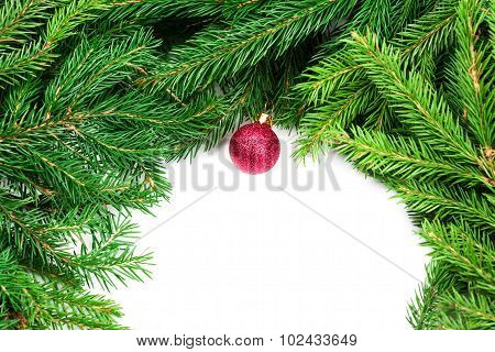Christmas Background With Fir Twigs And Red Balls Isolated On White