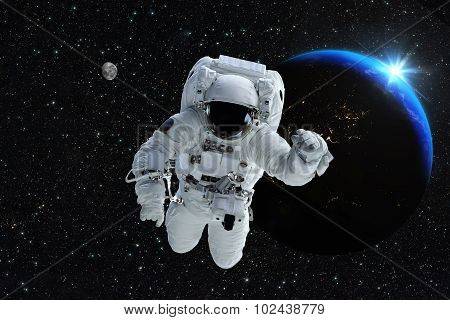 Astronaut spaceman outer space people planet earth moon. Beautiful blue sunrise. Elements of this image furnished by NASA. poster
