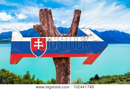 Slovakia Flag wooden sign with lake background