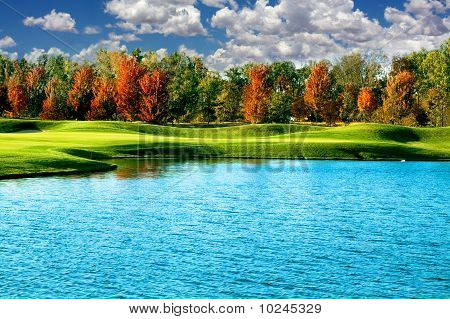 A Golf Course In The Fall With Lake