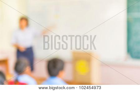 Blur Kids And Teacher In The Classroom.