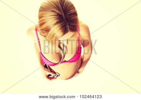 Well groomed pregnant woman with stethoscope on belly